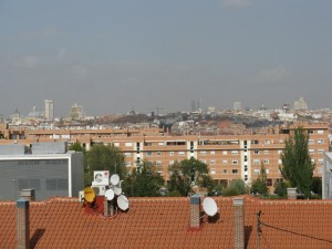 The upper floor where Paco works in Madrid has a great view of the city. To the left, you can see the Tower of Madrid and the other large building (with yellow building-stuff hanging on it) that are on the Plaza de España.