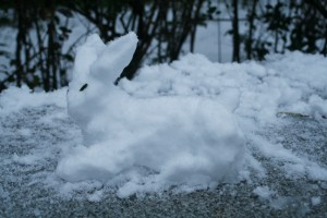 And another snow rabbit was sitting on a bench.